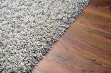 White Shaggy Carpet On Brown W...