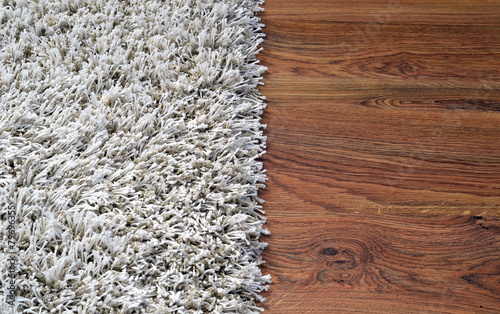 Photo Two part split image of white shaggy carpet and wooden floor
