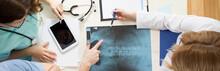 Doctors Analyzing Pelvis X-ray