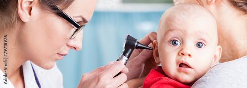 Pediatrician using otoscope Canvas Print
