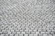 Dark gray granite cobble stone pavement, the base of the modern street architecture