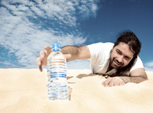 Thirsty Man Reaching For A Bottle Of Water