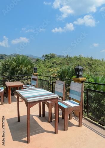Fototapeta Outdoor patio furniture with mountain view obraz na płótnie