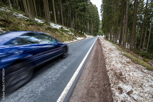 Fotografie, Obraz  fast car on a winter forest road