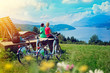 Leinwandbild Motiv girls with e-bikes enjoying view to a lake-sportive holidays 04
