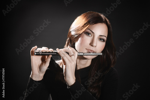 Fotografie, Obraz  Flute piccolo flutist playing flute music instrument