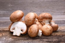 Brown Champignon On Wooden Background