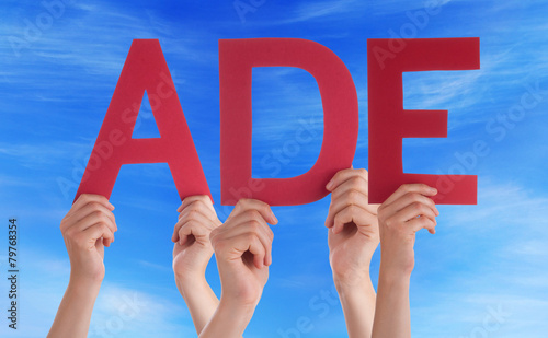 People Holding Straight German Word Ade Means Goodbye Blue Sky Canvas Print