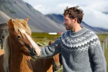 Icelandic Horses - Man Petting Horse On Iceland