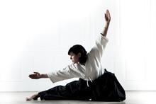 Beautiful Woman Wearing A Hakama Engaged In Kung Fu 1