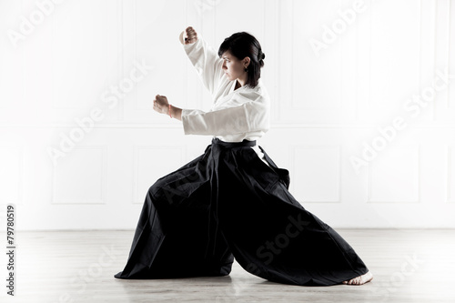 Tuinposter Vechtsport beautiful woman practicing Aikido 5