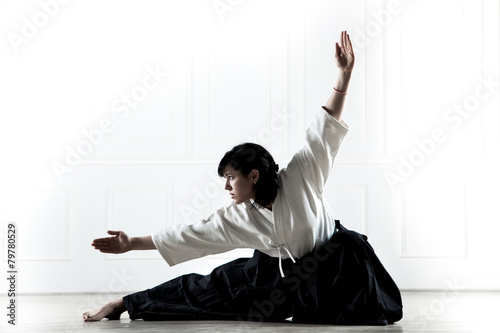 Fotografering  beautiful woman wearing a hakama engaged in kung Fu 1