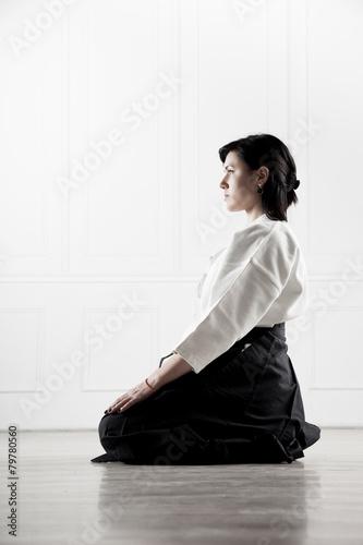 Fotografie, Obraz  beautiful, young woman meditating in a sports hall 3