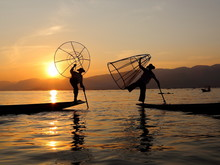 Sunset And Fishermen At Inle Lake