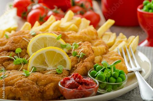 Spoed Fotobehang Eten Schnitzel, french fries and microgreens salad