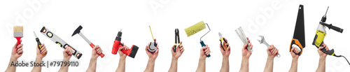 Fotografía Hands holding tools