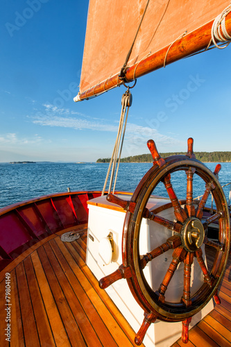 Staande foto Zeilen Sailboat at sea close up of wheel