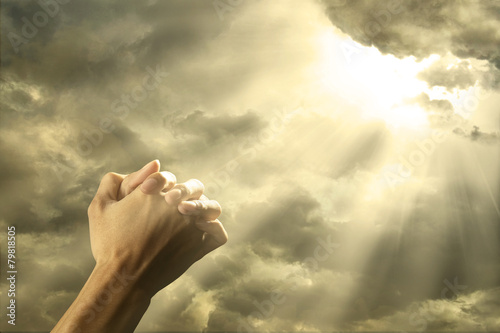 Fotografie, Obraz  Prayer raised hands on the sky