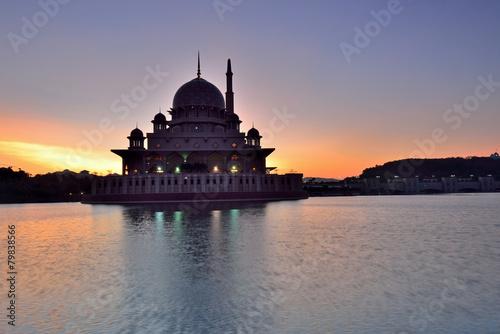 Fényképezés  Silhouette of Putrajaya mosque during sunrise