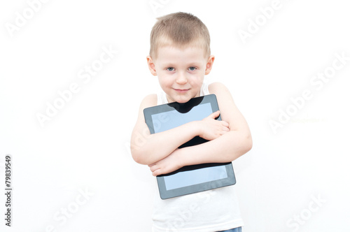 Photo  Child holding tablet PC