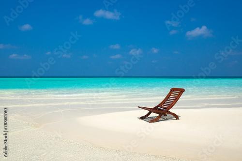 Obraz na plátně Beach lounger on sand beach.