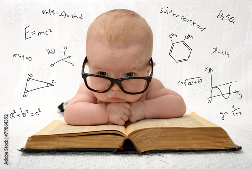 Photo  little baby in glasses with eauations around