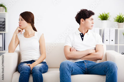 young Couple stress and  sitting on the sofa Canvas Print