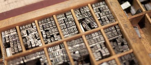 Close-up of metal letterpress letters in printing machine Fototapet