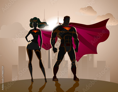 superhero couple male and female superheroes posing in front o