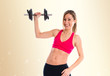 Happy sport woman doing weightlifting