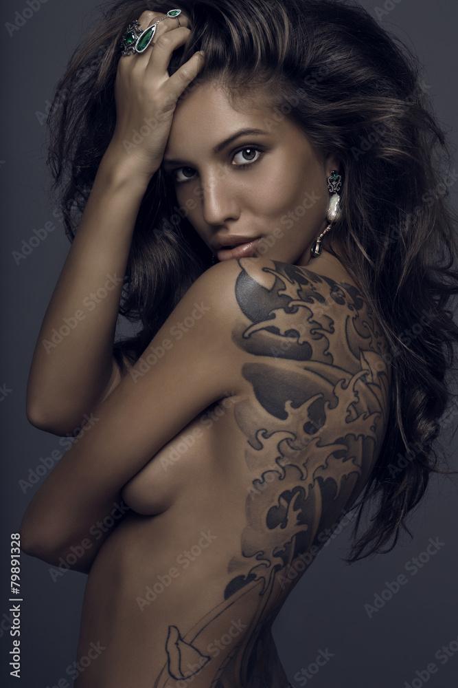Fototapeta Sensual brunette woman with tattoo