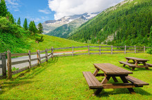 Wooden Benches For Visitors To...