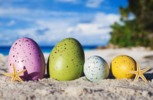 Colorful Easter Eggs On Ocean ...