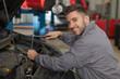 Mechanic fixing the engine