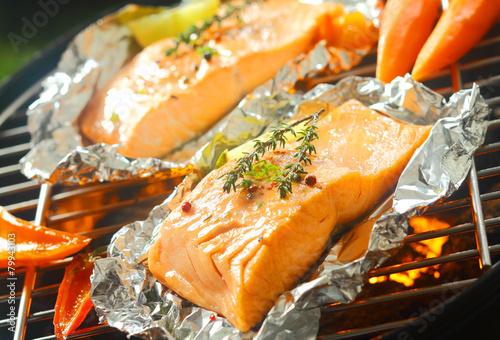 Aluminium Prints Grill / Barbecue Fresh marine salmon grilling over a barbecue
