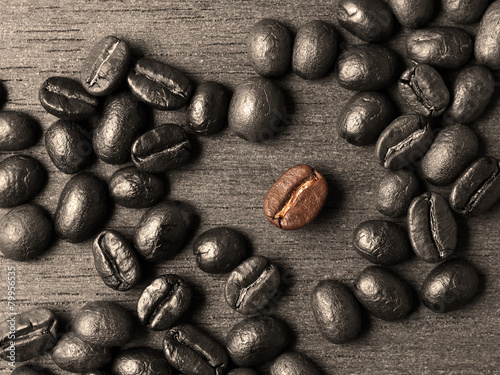 Coffee crop beans on wood texture background