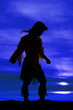 canvas print picture - silhouette of Native American woman arms out
