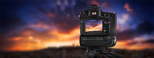 Dslr Camera Shooting On A Cityscape Sunset