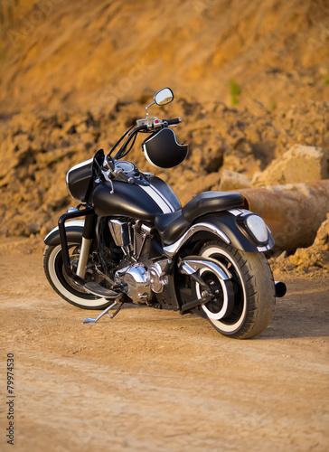 Photographie Big, clean, black and unknown chopper bike in desert