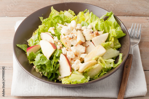 Fotografie, Obraz  salad with apples and walnuts on rustic wooden background
