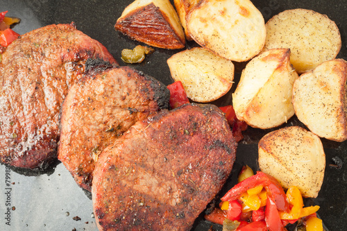 Succulent thick juicy portions of grilled fillet steak Poster