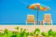 Beach umbrellas and sunbathe seats on Phuket sand beach in South