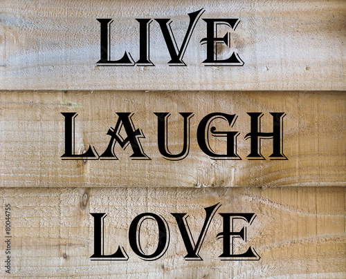 Live Laugh Love quote on a wooden background Wallpaper Mural
