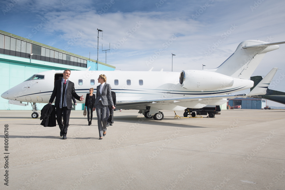 Fototapety, obrazy: executive business team leaving corporate private jet