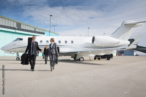 Leinwand Poster executive business team leaving corporate private jet