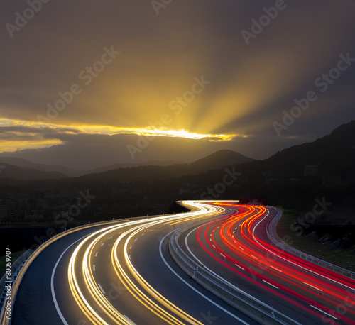 Sunset with car lights on highway Wallpaper Mural