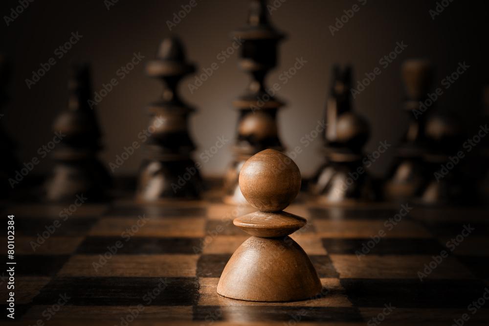 Fototapeta Chess. White pawn against all black.