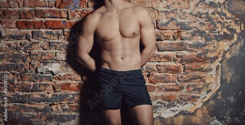 Fotografia  Image of muscle man posing in studio