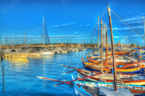 Photo  boats in Alghero harbor at sunset