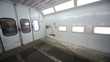 Inside empty paint-spraying booth with metal walls for cars